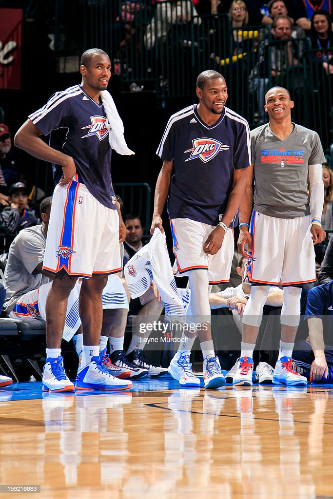 Oklahoma City Thunder players, from left, <a gi-track='captionPersonalityLinkClicked' href=/galleries/search?phrase=Serge+Ibaka&family=editorial&specificpeople=5133378 ng-click='$event.stopPropagation()'>Serge Ibaka</a> #9, <a gi-track='captionPersonalityLinkClicked' href=/galleries/search?phrase=Kevin+Durant&family=editorial&specificpeople=3847329 ng-click='$event.stopPropagation()'>Kevin Durant</a> #35 and <a gi-track='captionPersonalityLinkClicked' href=/galleries/search?phrase=Russell+Westbrook&family=editorial&specificpeople=4044231 ng-click='$event.stopPropagation()'>Russell Westbrook</a> #0 smile from the sideline during a game against the Minnesota Timberwolves on January 9, 2013 at the Chesapeake Energy Arena in Oklahoma City, Oklahoma.