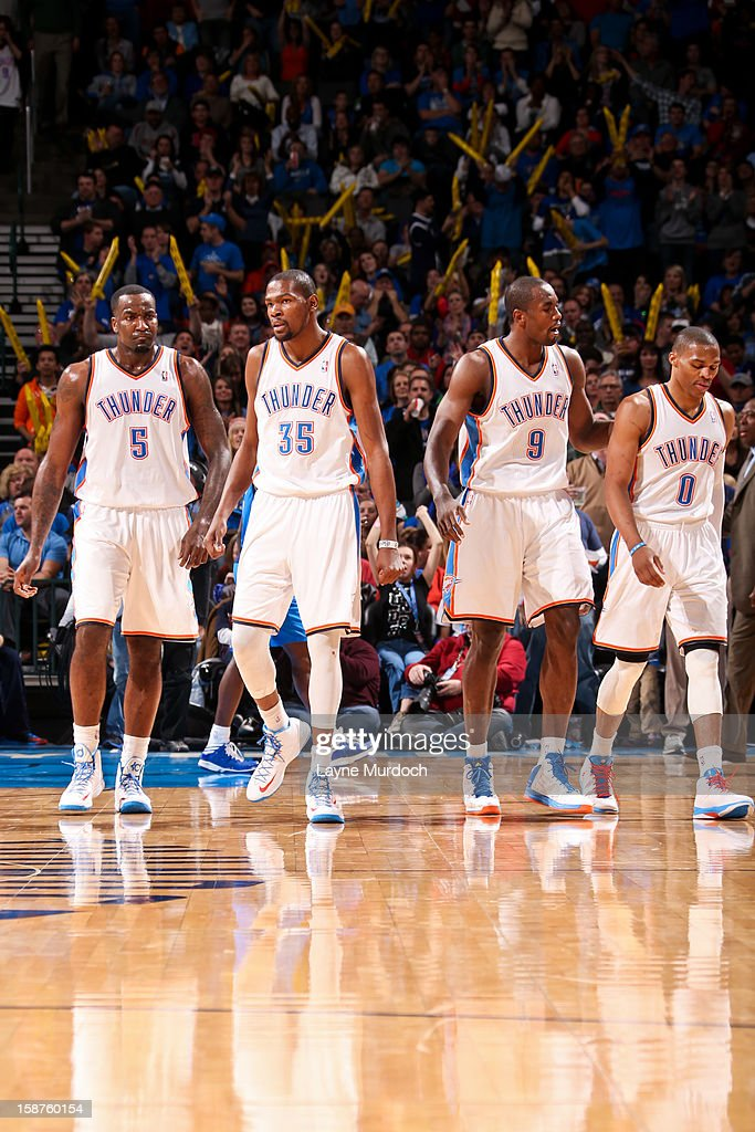 Oklahoma City Thunder players Kendrick Perkins #5, Kevin Durant #35, Serge Ibaka #9 and Russell Westbrook #0 celebrate during their game against the Dallas Mavericks on December 27, 2012 at the Chesapeake Energy Arena in Oklahoma City, Oklahoma.