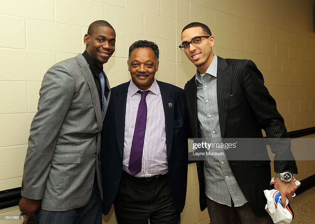 Oklahoma City Thunder players Ronnie Brewer #8 (L) and Kevin Martin #23 greet Reverend Jesse Jackson after the Thunder played the Denver Nuggets on March 19, 2013 at the Chesapeake Energy Arena in Oklahoma City, Oklahoma.