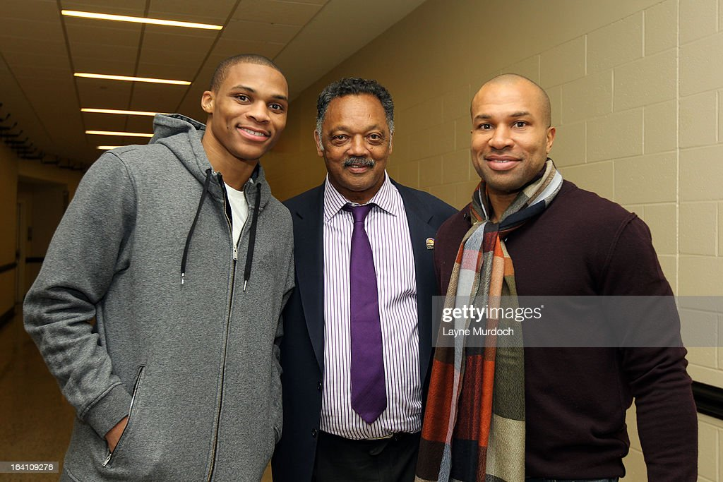 Oklahoma City Thunder players Russell Westbrook #0 (L) and Derek Fisher #6 greet Reverend Jesse Jackson after the Thunder played the Denver Nuggets on March 19, 2013 at the Chesapeake Energy Arena in Oklahoma City, Oklahoma.