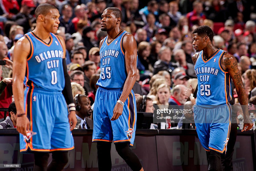 Oklahoma City Thunder players Russell Westbrook #0, Kevin Durant #35 and DeAndre Liggins #25 wait to resume action against the Portland Trail Blazers on January 13, 2013 at the Rose Garden Arena in Portland, Oregon.
