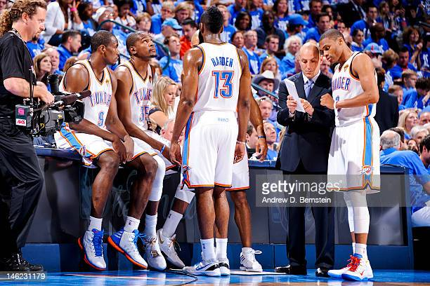 Oklahoma City Thunder players Serge Ibaka Kevin Durant James Harden and Russell Westbrook wait to resume action against the Miami Heat during Game...