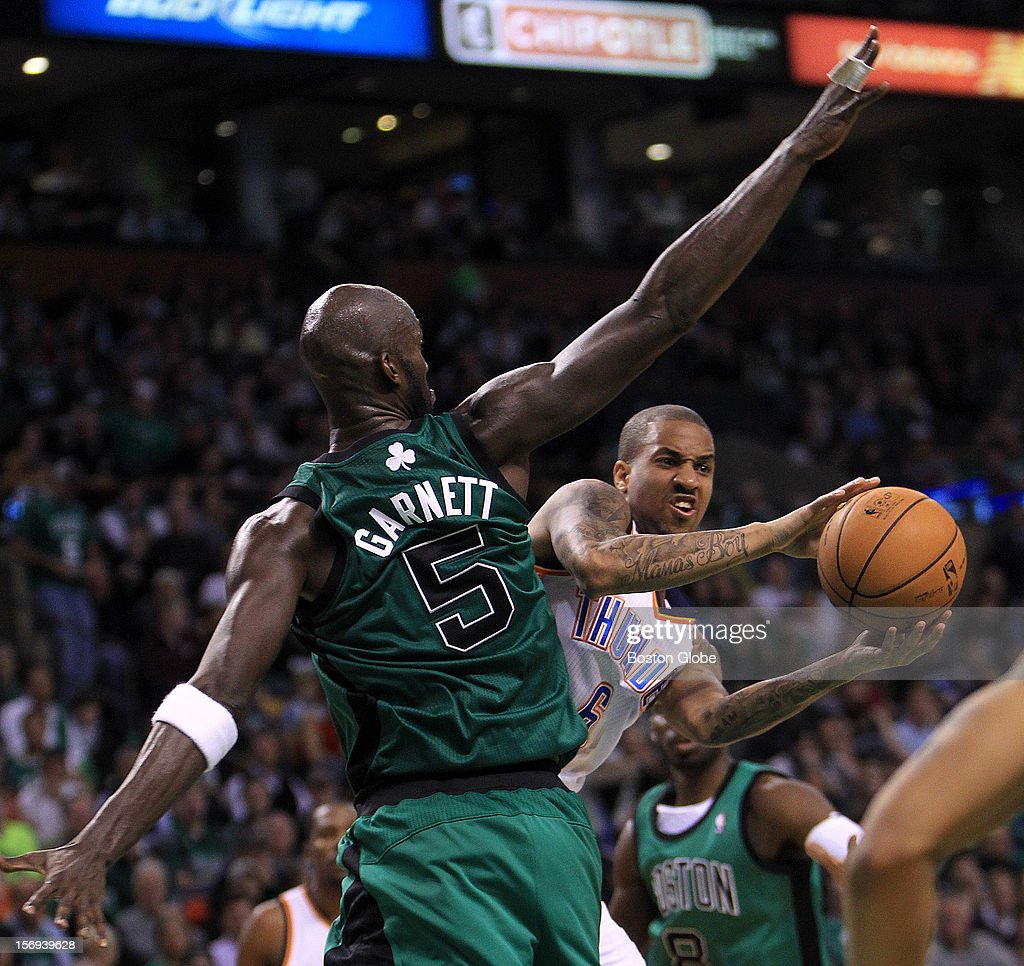 Oklahoma City Thunder point guard Eric Maynor (#6) looks for an outlet after his path to the hoop was blocked by Boston Celtics power forward Kevin Garnett (#5) during the fourth quarter. The Celtics play the Oklahoma City Thunder at TD Garden.