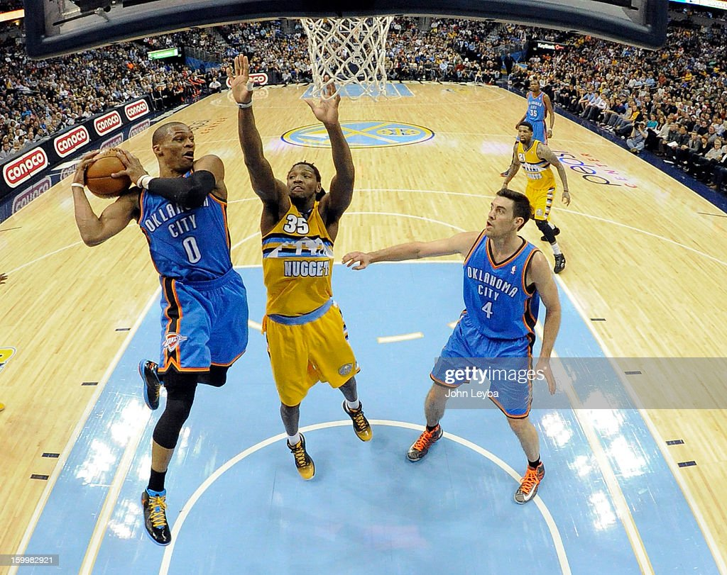 Oklahoma City Thunder point guard Russell Westbrook (0) drives to the basket on Denver Nuggets small forward Kenneth Faried (35) third quarter January 20, 2013 at Pepsi Center. The Denver Nuggets defeated the Oklahoma City Thunder 121-118.
