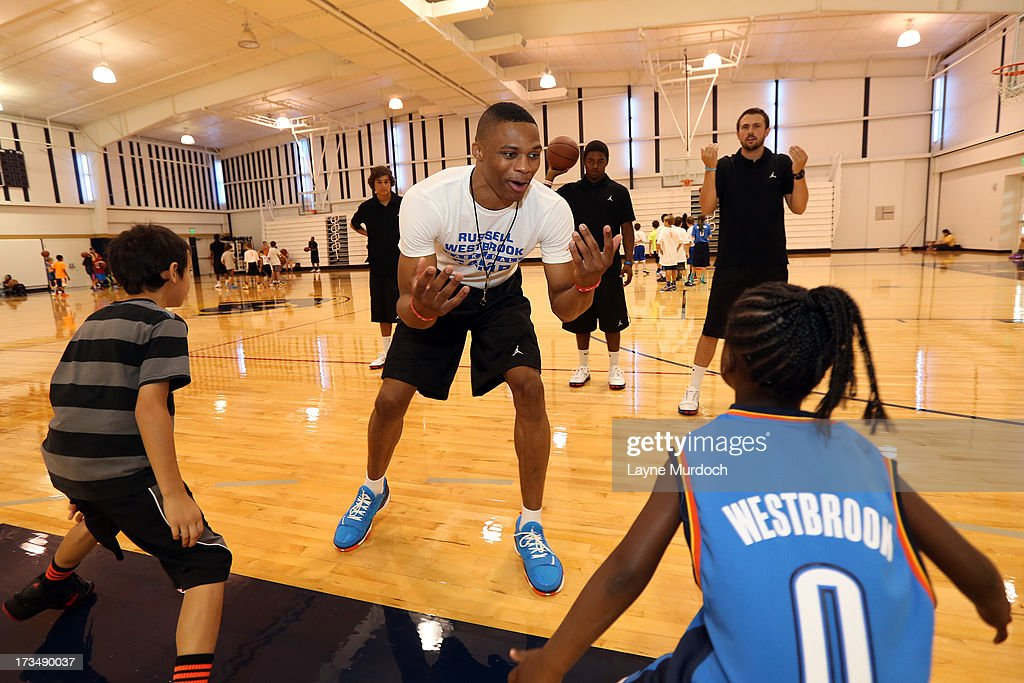 Oklahoma City Thunder <a gi-track='captionPersonalityLinkClicked' href=/galleries/search?phrase=Russell+Westbrook&family=editorial&specificpeople=4044231 ng-click='$event.stopPropagation()'>Russell Westbrook</a> coaches children at his basketball camp on July 10, 2013 at Heritage Hall in Oklahoma City, Oklahoma.