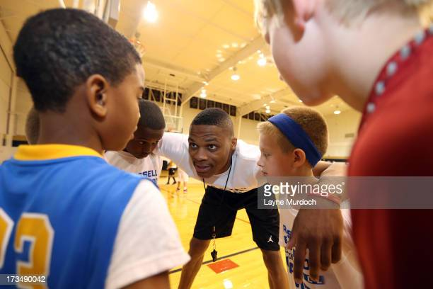 CITY OK JULY Oklahoma City Thunder Russell Westbrook coaches children at his basketball camp on July 10 2013 at Heritage Hall in Oklahoma City...