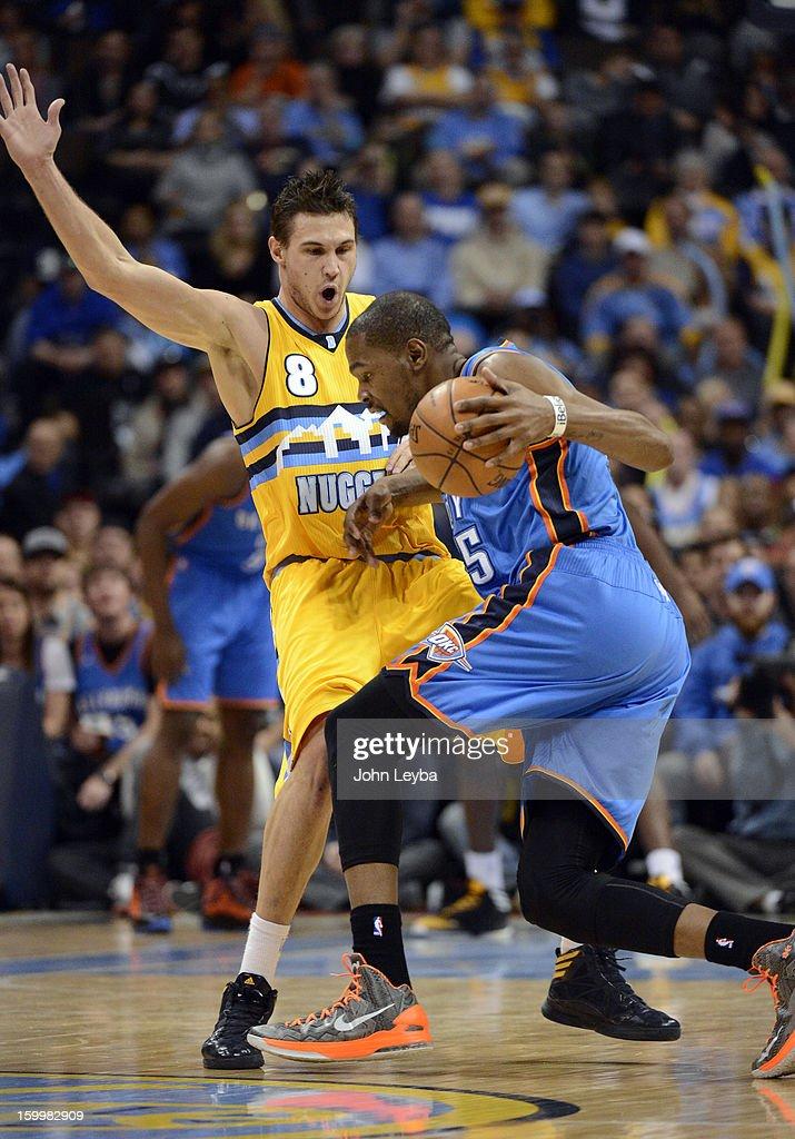 Oklahoma City Thunder small forward Kevin Durant (35) runs in to Denver Nuggets small forward Danilo Gallinari (8) during the first quarter January 20, 2013 at Pepsi Center.