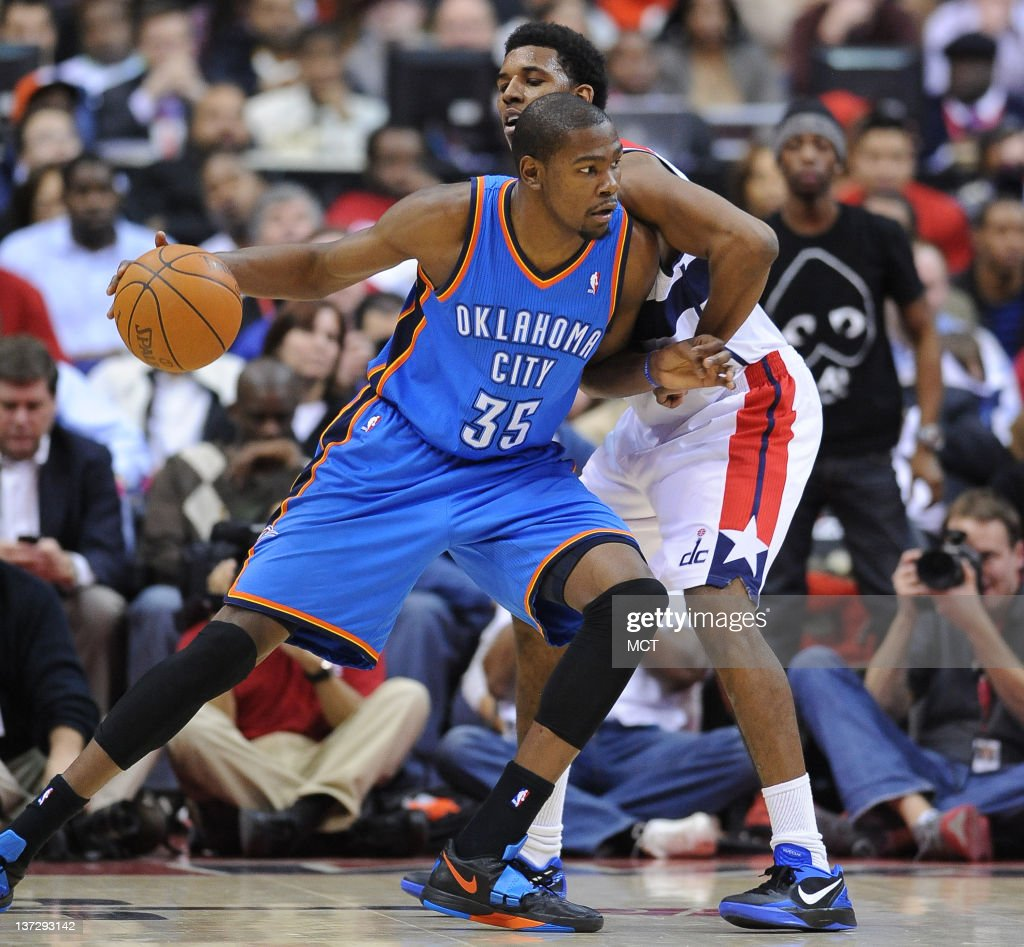 Oklahoma City Thunder small forward Kevin Durant works against the tight defense of Washington Wizards shooting guard Nick Young during the fourth...