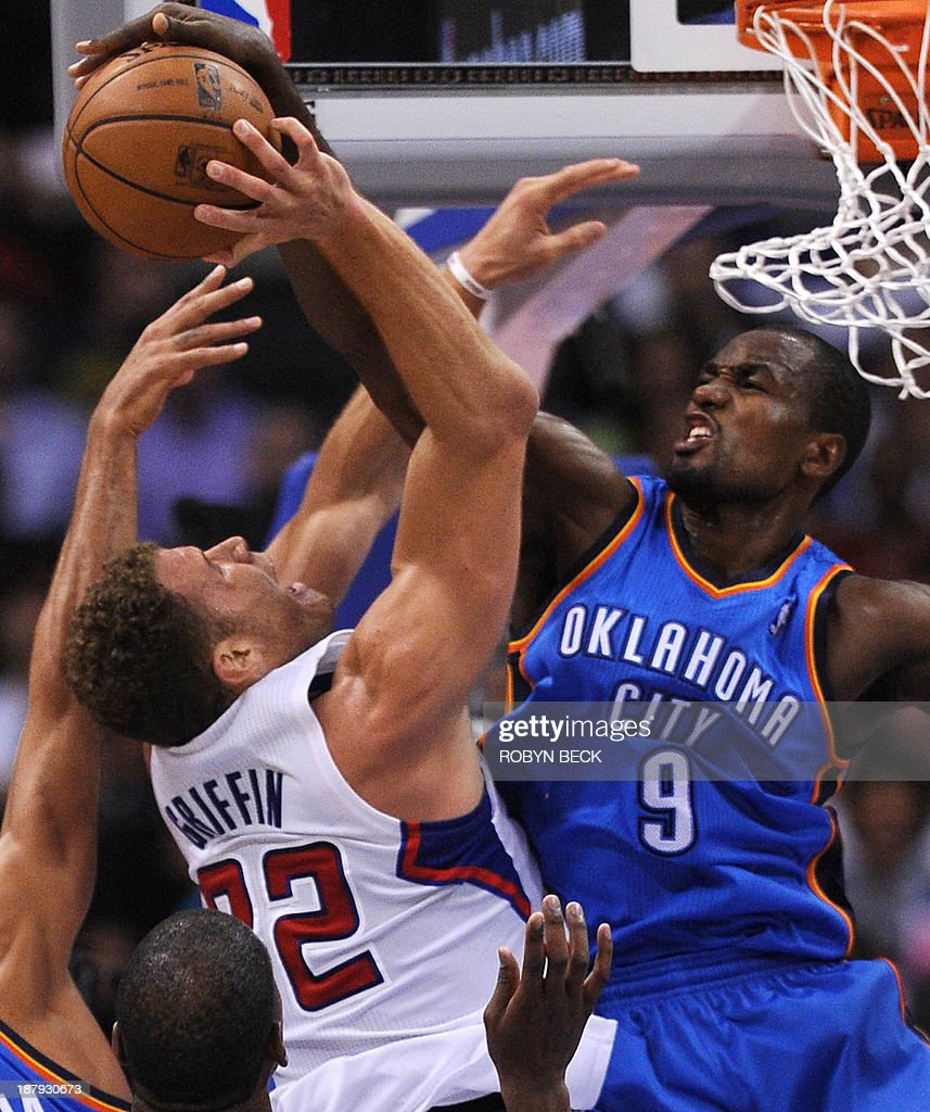 Oklahoma City Thunder's Serge Ibaka (R) fouls Los Angeles Clippers Blake Griffin (L) as Griffin attempts a shot in the final seconds of the second quarter, during NBA action, November 13, 2013 in Los Angeles, California. The play led to a skirmish between the two teams which resulted in Ibaka and the Clippers Matt Barnes being ejected from the game. AFP PHOTO / Robyn Beck