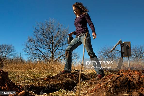 Oklahoma Geological Survey seismologist Amberlee Darold installs a seismometer in southwest Oklahoma City OK on January 26 2015 She and other...