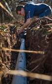 Oklahoma Geological Survey seismologist Austin Holland installs a seismometer in southwest Oklahoma City OK on January 26 2015 He and other...