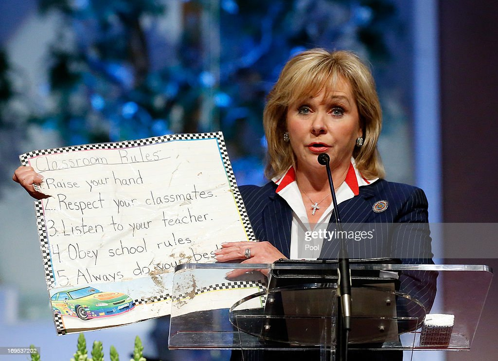 Oklahoma Govenor Mary Fallin displays a tablet of classroom rules that she recovered from the rubble of Plaza Towers Elementary School during the Oklahoma Strong memorial service held to honor victims of the recent deadly tornado at the First Baptist Church on May 26, 2013 in Moore, Oklahoma. The tornado of EF5 strength and two miles wide touched down May 20 killing at least 24 people and leaving behind extensive damage to homes and businesses. U.S. President Barack Obama visited the area Sunday and promised federal aid to supplement state and local recovery efforts.