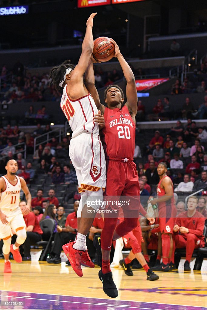 Oklahoma guard Kameron McGusty (20) tries to shoot over USC guard Elijah Stewart (30) during an college basketball game between the Oklahoma Sooners and the USC Trojans in the Basketball Hall of Fame Classic on December 8, 2017 at STAPLES Center in Los Angeles, CA.
