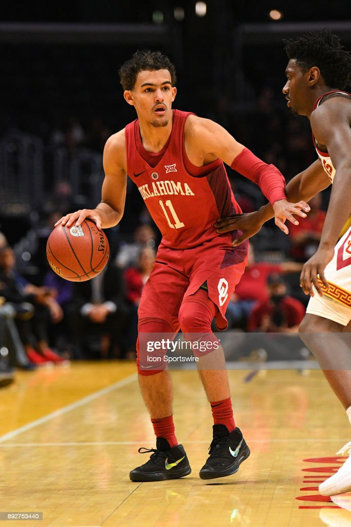 Oklahoma guard Trae Young (11) looks to drive to the basket during an college basketball game between the Oklahoma Sooners and the USC Trojans in the Basketball Hall of Fame Classic on December 8, 2017 at STAPLES Center in Los Angeles, CA.