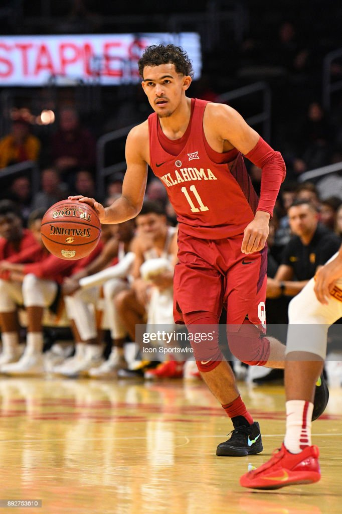 Oklahoma guard Trae Young (11) sets up the offense during an college basketball game between the Oklahoma Sooners and the USC Trojans in the Basketball Hall of Fame Classic on December 8, 2017 at STAPLES Center in Los Angeles, CA.