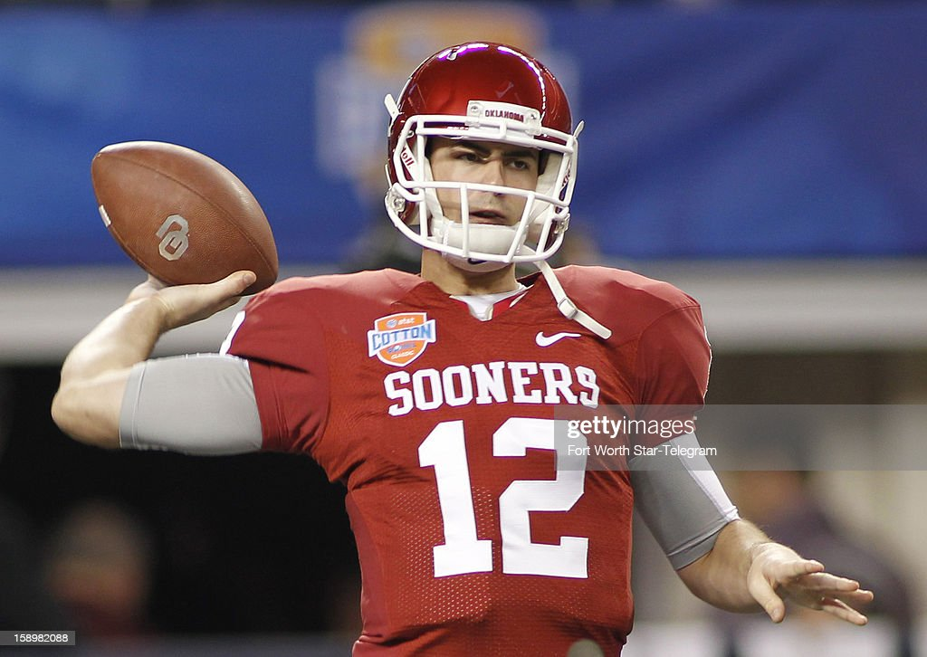 Oklahoma quarterback Landry Jones warms up prior to action against Texas A&M in the AT&T Cotton Bowl game in Cowboys Stadium in Arlington, Texas, on Friday, January 4, 2013.