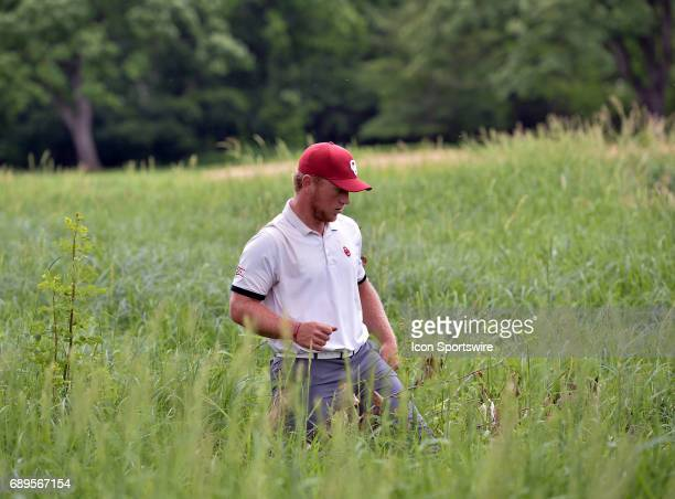 Oklahoma Sooners Brad Dalke looks for his lost ball during round 3 of the Division I Men's Golf Championships on May 28 2017 at Rich Harvest Farms in...