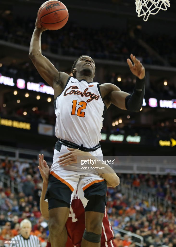 Oklahoma Sooners center Jamuni McNeace (4) hooks to Oklahoma State Cowboys forward Cameron McGriff (12) to prevent a dunk in the second half of a first round matchup in the Big 12 Basketball Championship between the Oklahoma Sooners and Oklahoma State Cowboys on March 7, 2018 at Sprint Center in Kansas City, MO. Oklahoma State won 71-60.