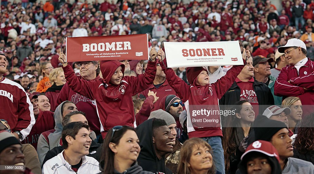 Oklahoma Sooners fans celebrate during the game against the Oklahoma State Cowboys November 24, 2012 at Gaylord Family-Oklahoma Memorial Stadium in Norman, Oklahoma. Oklahoma defeated Oklahoma State 51-48 in overtime.