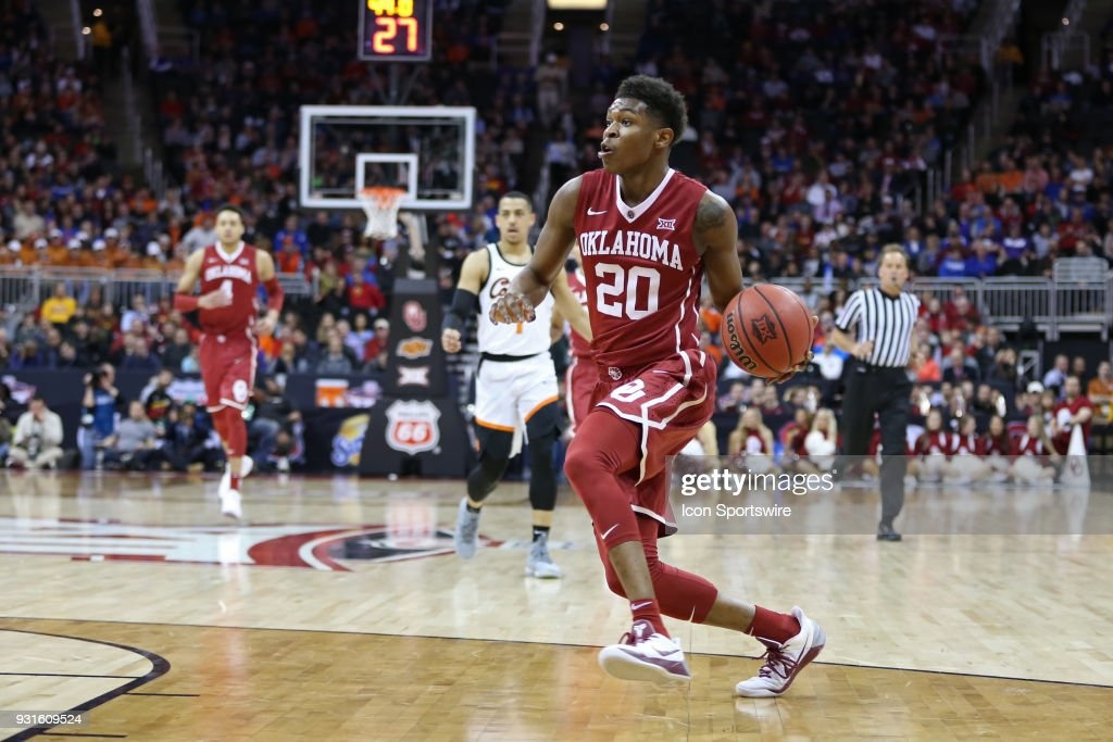 Oklahoma Sooners guard Kameron McGusty (20) drives to the basket in the first half of a first round matchup in the Big 12 Basketball Championship between the Oklahoma Sooners and Oklahoma State Cowboys on March 7, 2018 at Sprint Center in Kansas City, MO.