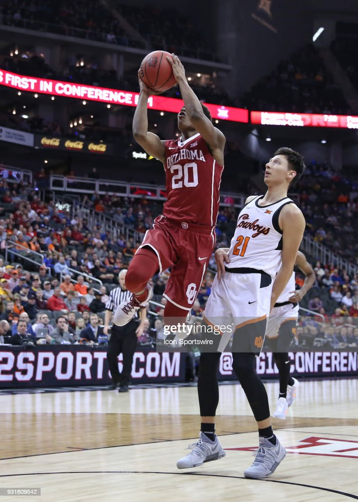 Oklahoma Sooners guard Kameron McGusty (20) leaps for a layup in the first half of a first round matchup in the Big 12 Basketball Championship between the Oklahoma Sooners and Oklahoma State Cowboys on March 7, 2018 at Sprint Center in Kansas City, MO.