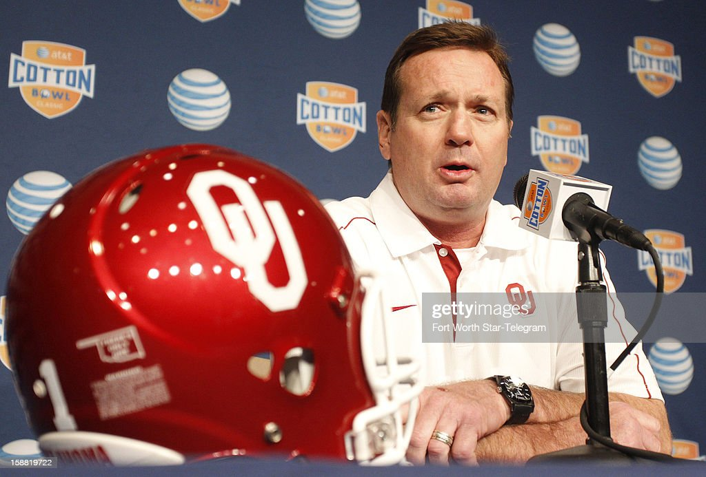 Oklahoma Sooners head coach Bob Stoops answers questions from the media during the Cotton Bowl Media Day at Cowboys Stadium Sunday, December 30, 2012.