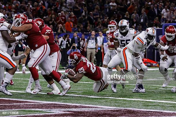 Oklahoma Sooners running back Joe Mixon dives intro the end zone for a touchdown during the game between the Auburn Tigers and the Oklahoma Sooners...