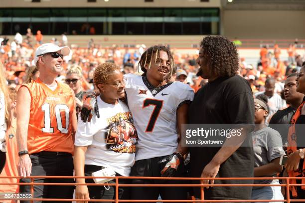 Oklahoma State Cowboys DB Ramon Richards who sealed victory with an interception joins friends and family in the stands after defeating the Texas...