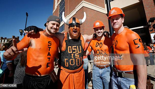 Oklahoma State Cowboys fans pose before the game against the TCU Horned Frogs November 7 2015 at Boone Pickens Stadium in Stillwater Oklahoma