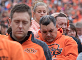 Oklahoma State Cowboys football fans hold a moment of silence for the people killed in car crash at the homecoming parade before the first quarter of...