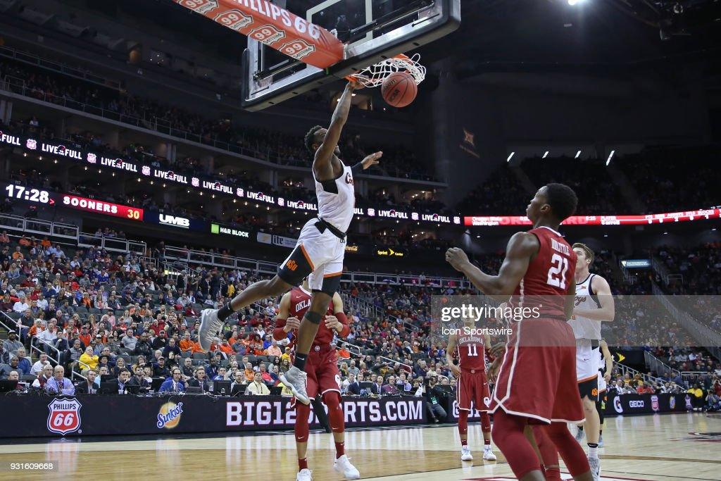 Oklahoma State Cowboys forward Cameron McGriff (12) leaps for a monster dunk with 17:28 remaining in the second half of a first round matchup in the Big 12 Basketball Championship between the Oklahoma Sooners and Oklahoma State Cowboys on March 7, 2018 at Sprint Center in Kansas City, MO. Oklahoma State won 71-60.