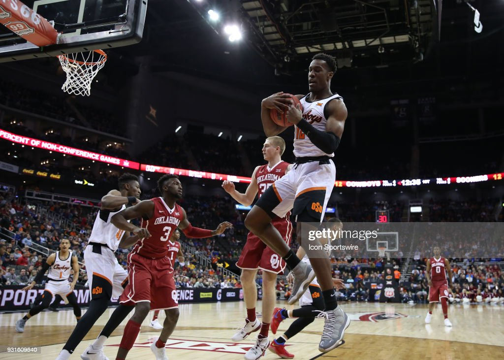 Oklahoma State Cowboys forward Cameron McGriff (12) pulls down the rebound in the first half of a first round matchup in the Big 12 Basketball Championship between the Oklahoma Sooners and Oklahoma State Cowboys on March 7, 2018 at Sprint Center in Kansas City, MO.