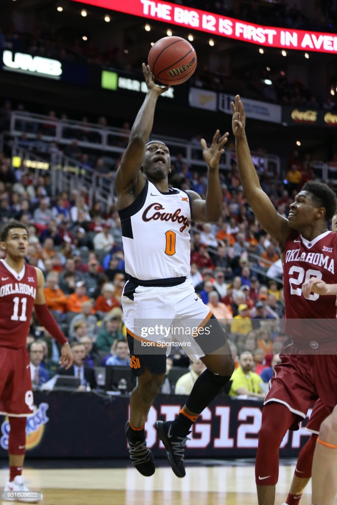 Oklahoma State Cowboys guard Brandon Averette (0) shoots a jumper ovver Oklahoma Sooners guard Kameron McGusty (20) in the second half of a first round matchup in the Big 12 Basketball Championship between the Oklahoma Sooners and Oklahoma State Cowboys on March 7, 2018 at Sprint Center in Kansas City, MO. Oklahoma State won 71-60.