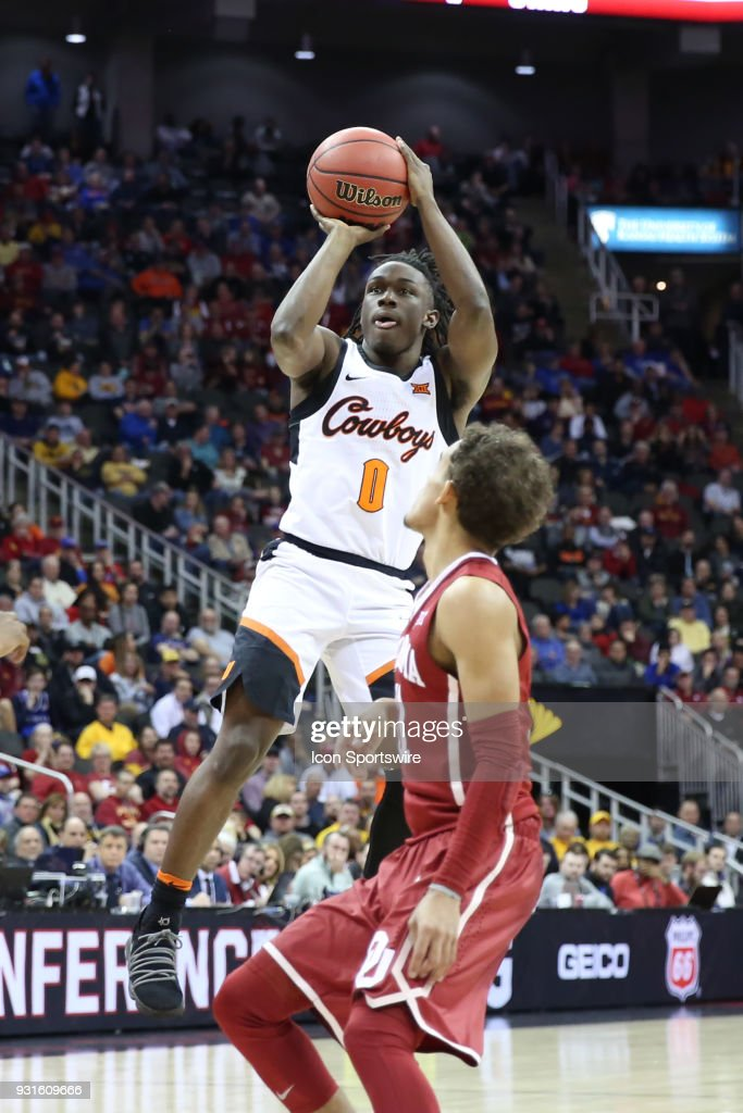 Oklahoma State Cowboys guard Brandon Averette (0) shoots a three in the second half of a first round matchup in the Big 12 Basketball Championship between the Oklahoma Sooners and Oklahoma State Cowboys on March 7, 2018 at Sprint Center in Kansas City, MO. Oklahoma State won 71-60.