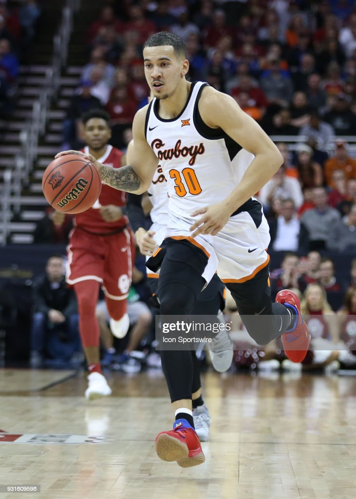 Oklahoma State Cowboys guard Jeffrey Carroll (30) bring the ball upcourt in the second half of a first round matchup in the Big 12 Basketball Championship between the Oklahoma Sooners and Oklahoma State Cowboys on March 7, 2018 at Sprint Center in Kansas City, MO. Oklahoma State won 71-60.