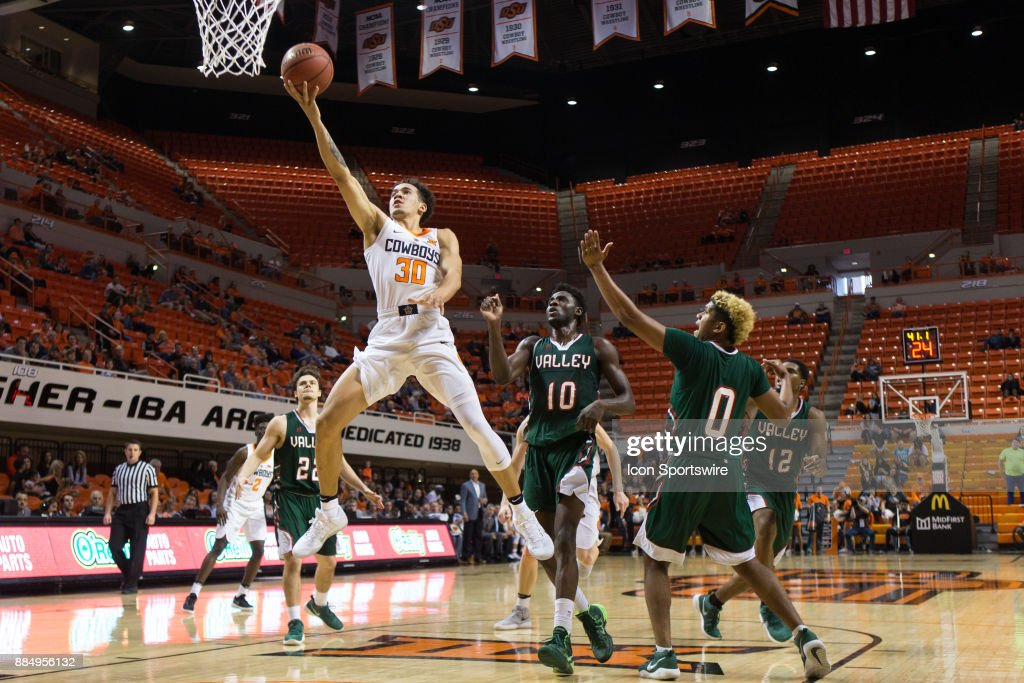 Oklahoma State Cowboys guard Jeffrey Carroll (30) puts up a shot during the college division 1 mens basketball game between the Mississippi Valley State Delta Devils and the Oklahoma State Cowboys on December 3, 2017 at Gallagher-Iba arena in Stillwater, Oklahoma.