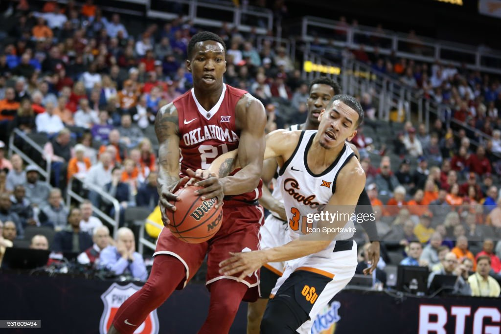 Oklahoma State Cowboys guard Jeffrey Carroll (30) reaches in and fouls Oklahoma Sooners forward Kristian Doolittle (21) in the first half of a first round matchup in the Big 12 Basketball Championship between the Oklahoma Sooners and Oklahoma State Cowboys on March 7, 2018 at Sprint Center in Kansas City, MO.