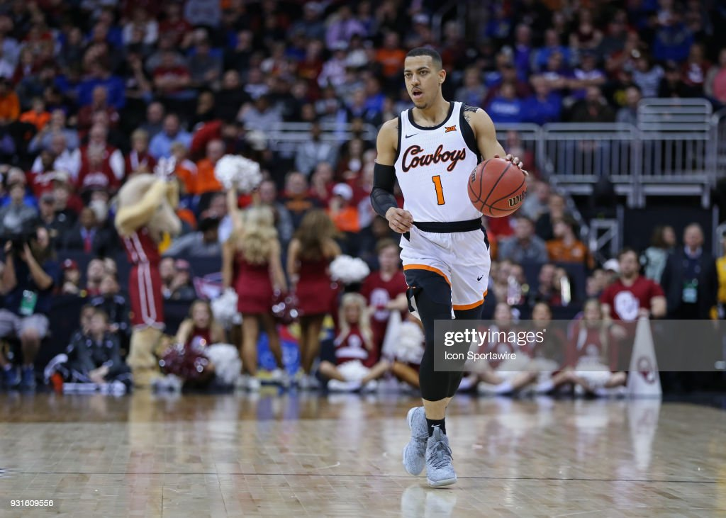 Oklahoma State Cowboys guard Kendall Smith (1) brings the ball upcourt in the second half of a first round matchup in the Big 12 Basketball Championship between the Oklahoma Sooners and Oklahoma State Cowboys on March 7, 2018 at Sprint Center in Kansas City, MO. Oklahoma State won 71-60.