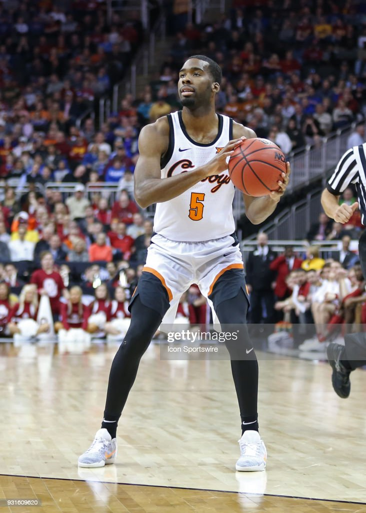 Oklahoma State Cowboys guard Tavarius Shine (5) looks to pass in the second half of a first round matchup in the Big 12 Basketball Championship between the Oklahoma Sooners and Oklahoma State Cowboys on March 7, 2018 at Sprint Center in Kansas City, MO. Oklahoma State won 71-60.
