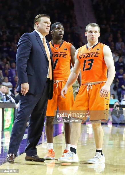 Oklahoma State Cowboys head coach Brad Underwood guard Jawun Evans and Phil Forte III in the second half of a Big 12 matchup between the Oklahoma...