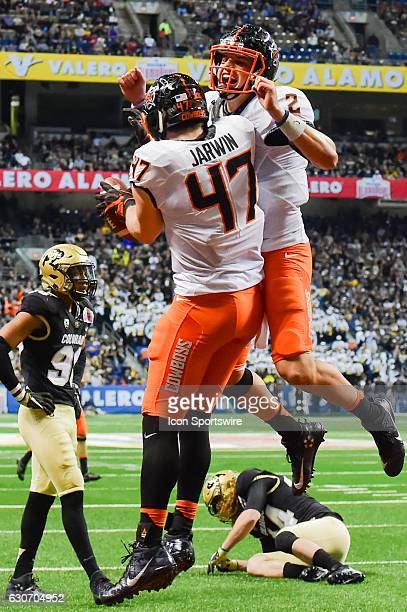 Oklahoma State Cowboys quarterback Mason Rudolph celebrates Oklahoma State Cowboys tight end Blake Jarwin's second half touchdown reception during...