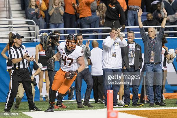 Oklahoma State Cowboys tight end Blake Jarwin looks back after scoring a touchdown during the Valero Alamo Bowl between the Colorado Buffaloes and...