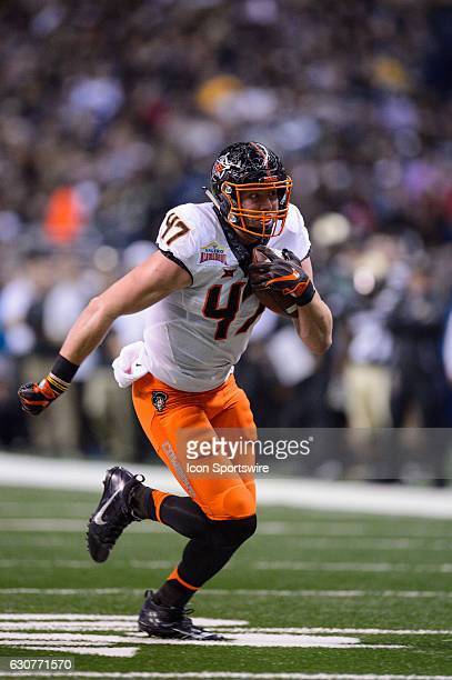 Oklahoma State Cowboys tight end Blake Jarwin runs after a catch during the Valero Alamo Bowl between the Colorado Buffaloes and Oklahoma State...