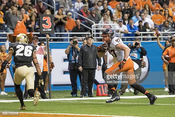 Oklahoma State Cowboys tight end Blake Jarwin runs toward the end zone during the Valero Alamo Bowl between the Colorado Buffaloes and Oklahoma State...