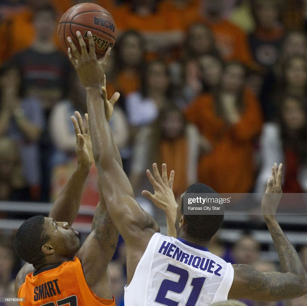 Oklahoma State's Marcus Smart has his shot blocked by Kansas State's Jordan Henriquez (21) in the first half of the Big 12 Tournament semifinals at the Sprint Center in Kansas City, Missouri, on Friday, March 15, 2013