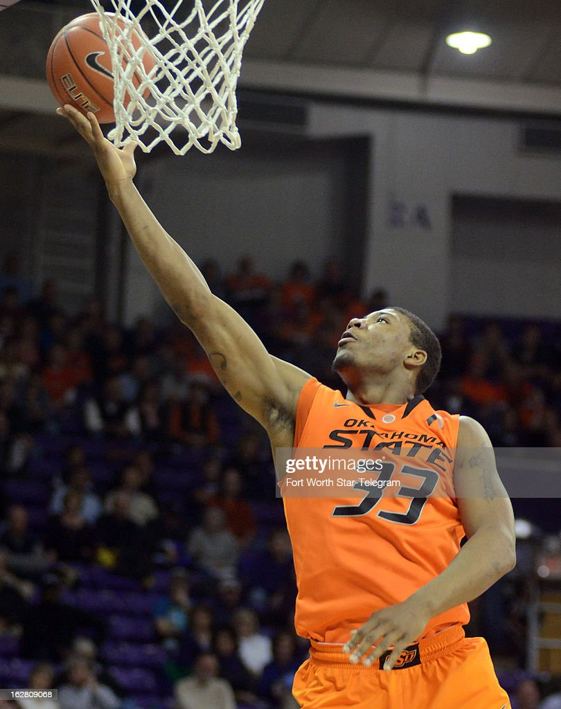 Oklahoma State's Marcus Smart lays the ball into the basket against Texas Christian during the first half on Wednesday, February 27, 2013, at the Daniel-Meyer Colesium in Fort Worth, Texas. Oklahoma State won, 64-47.