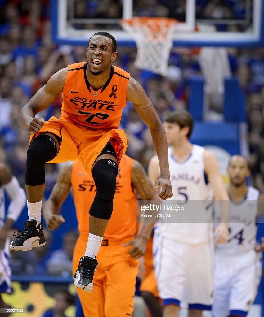 Oklahoma State's Markel Brown, who poured in a game-high 28 points, jumps for joy after an 85-80 upset of Kansas at Allen Fieldhouse in Lawrence, Kansas, on Saturday, February 2, 2013.