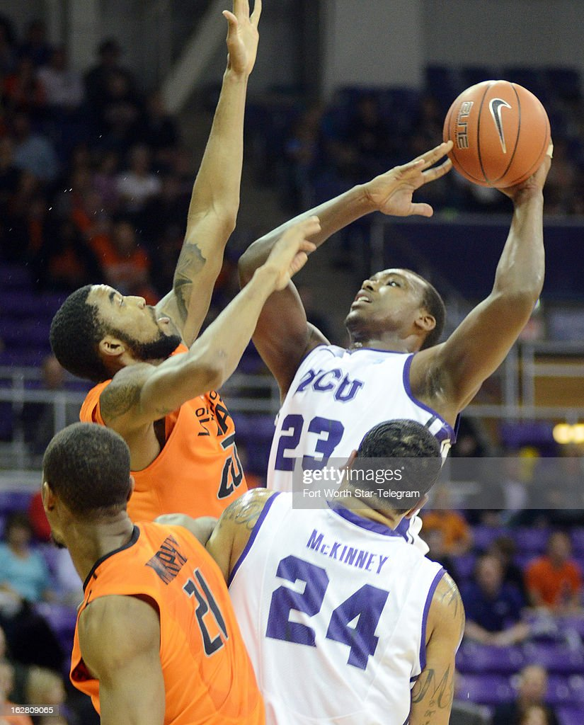 Oklahoma State's Michael Cobbins, left tries, to block Texas Christian's Devonta Abron as he goes up for a jump shot during the first half on Wednesday, February 27, 2013, at the Daniel-Meyer Colesium in Fort Worth, Texas. Oklahoma State won, 64-47.