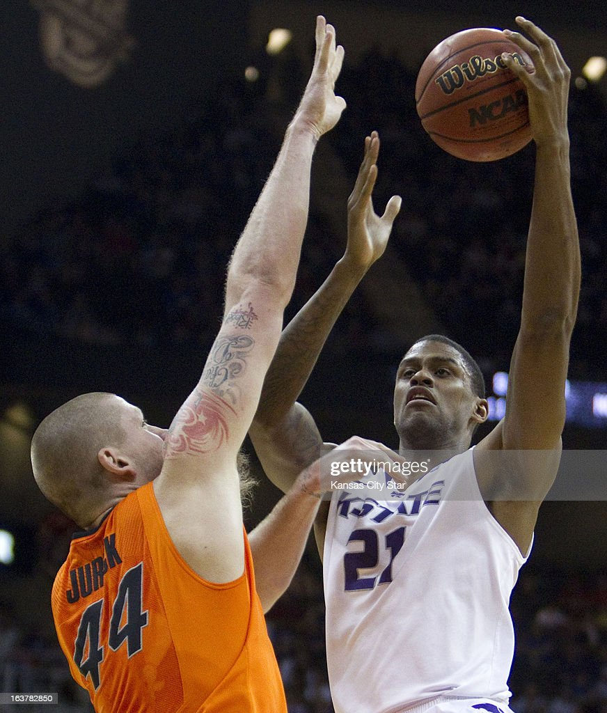 Oklahoma State's Philip Jurick (44) defends as Kansas State's Jordan Henriquez (21) shoots in the first half of the Big 12 Tournament semifinals at the Sprint Center in Kansas City, Missouri, on Friday, March 15, 2013