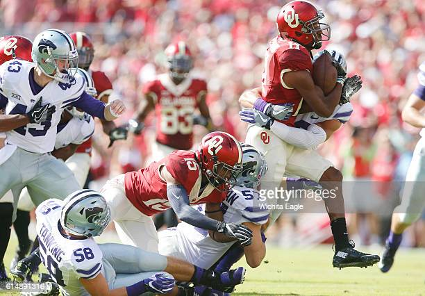 Oklahoma wide receiver Dede Westbrook churns through he Kansas State defense on Saturday Oct 15 at Memorial Stadium in Norman Okla The host Sooners...